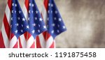 three american flags in front... | Shutterstock . vector #1191875458