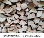 folded firewood. texture.... | Shutterstock . vector #1191876322
