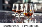 cups with a cognac rumbrandy or ... | Shutterstock . vector #1191889738
