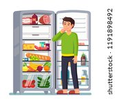 man stands by the fridge... | Shutterstock .eps vector #1191898492