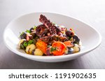 gnocchi with fresh vegetables ... | Shutterstock . vector #1191902635