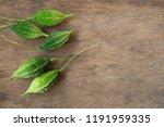 bitter gourd fruits on wooden ... | Shutterstock . vector #1191959335