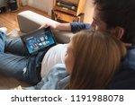 couple using digital tablet for ... | Shutterstock . vector #1191988078