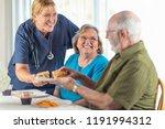 female doctor or nurse serving... | Shutterstock . vector #1191994312
