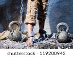 Small photo of Legs in heavy iron shackles