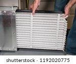 senior caucasian man changing a ...   Shutterstock . vector #1192020775