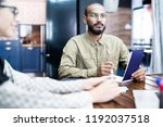 serious hipster bearded man in... | Shutterstock . vector #1192037518
