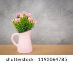 pink flower pot on table and... | Shutterstock . vector #1192064785
