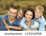 big cute family posing outdoors ... | Shutterstock . vector #119216908