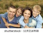 big cute family posing outdoors ... | Shutterstock . vector #119216908