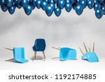 Blue Chairs Lying On White Roo...