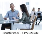 manager prepares the contract... | Shutterstock . vector #1192223932