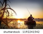 fishing. sunset on the lake. | Shutterstock . vector #1192241542