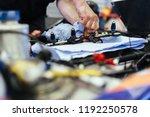 car mechanic or service man... | Shutterstock . vector #1192250578