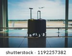 two suitcases in airport... | Shutterstock . vector #1192257382