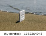 white audio tape on the beach | Shutterstock . vector #1192264048