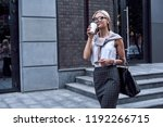 young stylish woman walking on... | Shutterstock . vector #1192266715