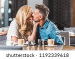 affectionate couple kissing at... | Shutterstock . vector #1192339618