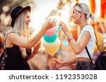 happy female friends in... | Shutterstock . vector #1192353028