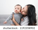young mother with her one years ... | Shutterstock . vector #1192358902
