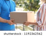 woman receiving parcel from... | Shutterstock . vector #1192362562