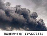 dangerous clouds of black smoke ... | Shutterstock . vector #1192378552