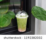 a plastic glass of iced green... | Shutterstock . vector #1192382032