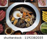 grilling raw seafood such as... | Shutterstock . vector #1192382035