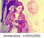 woman participates in a social... | Shutterstock . vector #1192412002