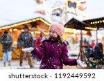 little cute kid girl having fun ... | Shutterstock . vector #1192449592