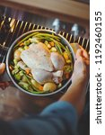 cook putting raw chicken with... | Shutterstock . vector #1192460155