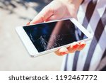 broken smartphone in woman's... | Shutterstock . vector #1192467772