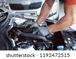 auto mechanic working in garage.... | Shutterstock . vector #1192472515