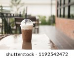 iced coffee on a wooden table...   Shutterstock . vector #1192542472