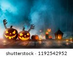 halloween pumpkins on old... | Shutterstock . vector #1192542952