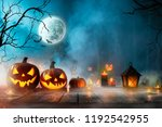 halloween pumpkins on old... | Shutterstock . vector #1192542955