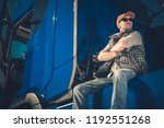 young caucasian trucker wearing ... | Shutterstock . vector #1192551268