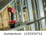 Steel Skeleton Frame Building and the Power Tool Drill Driver. Construction Site. - stock photo