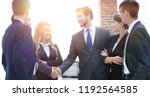 business handshake of... | Shutterstock . vector #1192564585