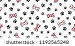 Stock vector dog paw seamless pattern vector christmas santa claus xmas dog bone french bulldog tile background 1192565248