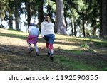 mother and daughter hiking in... | Shutterstock . vector #1192590355