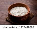 Small photo of Plain curd or yogurt or Dahi in Hindi, served in a bowl over moody background. Selective focus
