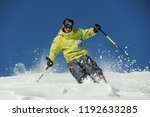 happy skier dressed in bright... | Shutterstock . vector #1192633285