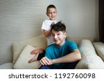 the younger brother plays with... | Shutterstock . vector #1192760098