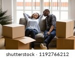 black married couple sitting on ... | Shutterstock . vector #1192766212