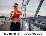 sportswoman workout outside | Shutterstock . vector #1192781008