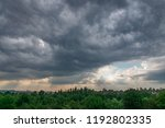 A Dark Gray Clouds Hovered Ove...