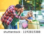 young smiling parents and their ... | Shutterstock . vector #1192815388