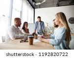 young team of coworkers making... | Shutterstock . vector #1192820722