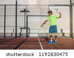 sportsman playing padel game | Shutterstock . vector #1192830475